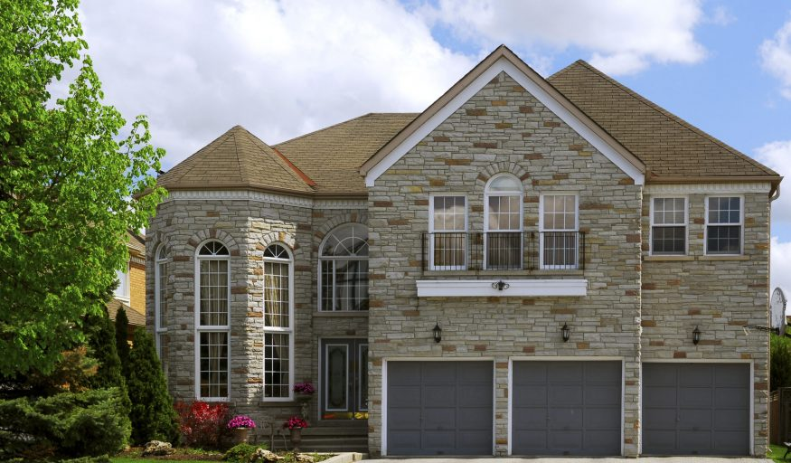 Big luxury residential house with natural stone facing