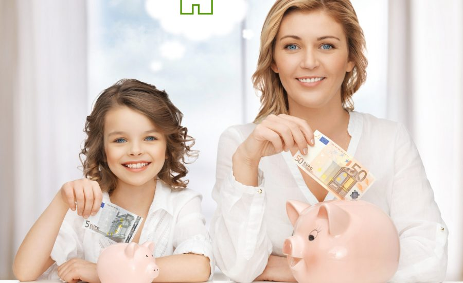 home, real estate and family concept - mother and daughter saving money for new house
